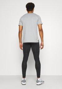4F - Men's training leggings - Collants - black - 2