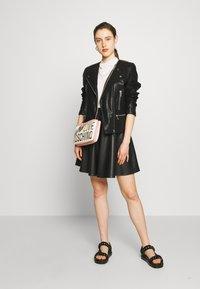 DKNY - MOTO JACKET - Faux leather jacket - black - 1