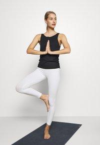 Nike Performance - YOGA RUCHE TANK - Treningsskjorter - black - 1