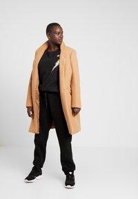Urban Classics - LADIES CARGO PANTS - Tracksuit bottoms - black - 1