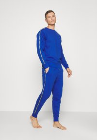 Diesel - UMLB-PETER TROUSERS - Pyjama bottoms - blue - 1
