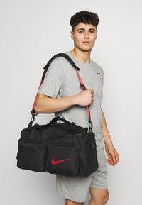 Nike Performance - UTILITY S DUFF - Sports bag - black/track red - 1