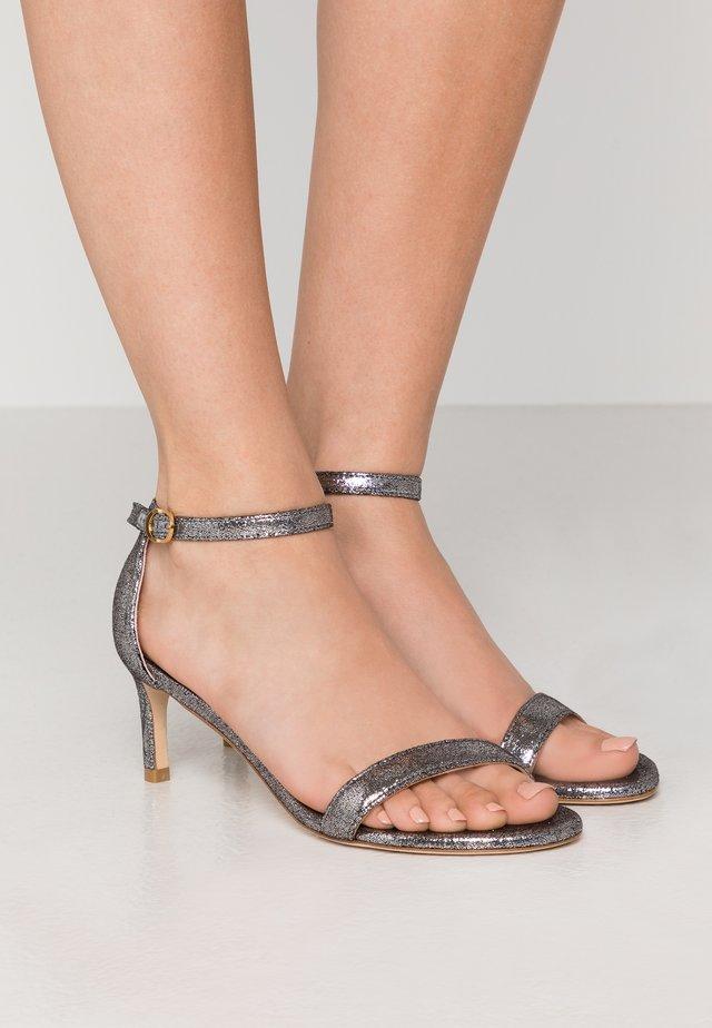 Sandaalit nilkkaremmillä - silver