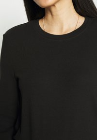 CALANDO - Long sleeved top - black