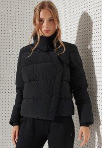 Superdry - FLEX PUFFER - Winter jacket - black - 0