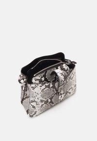 Calvin Klein - XBODY PYTHON - Across body bag - grey - 2