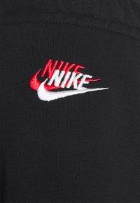 Nike Sportswear - Tracksuit bottoms - black - 2