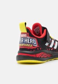 adidas Performance - FORTARUN SUPERHERO UNISEX - Neutral running shoes - core black/footwear white/vivid red - 5
