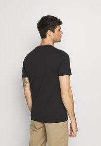 YOURTURN - UNISEX - Print T-shirt - black - 2