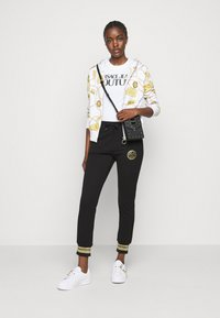 Versace Jeans Couture - Tracksuit bottoms - black/gold - 1