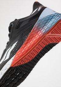 Reebok - NANO X - Chaussures d'entraînement et de fitness - black/white/vivid orange - 11
