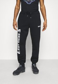 Blood Brother - HANOVER PARK UNISEX - Tracksuit bottoms - black - 0