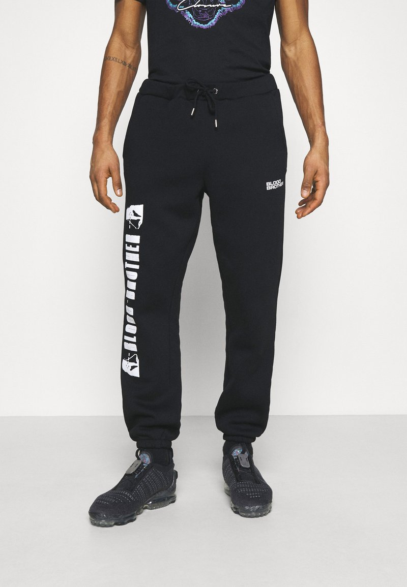 Blood Brother - HANOVER PARK UNISEX - Tracksuit bottoms - black