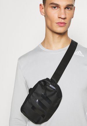 TAILORED HER SPORTS WAISTBAG UNISEX - Ledvinka - black/white
