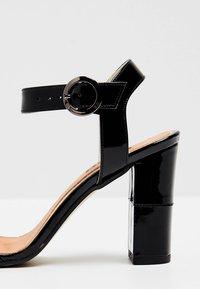 usha - Sandály na vysokém podpatku - black - 6