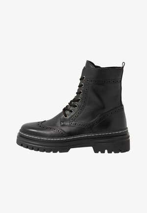 Platform ankle boots - schwarz/weiß