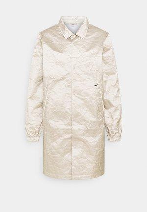 LONG COACHES - Halflange jas - cream