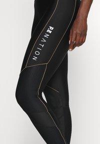 P.E Nation - DRIVE FORCE CAT SUIT - Gym suit - black/orange - 5