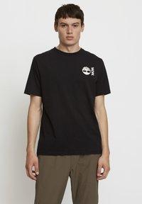 Timberland - WOODWOOD - T-shirt med print - black - 0
