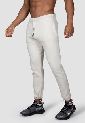 Tracksuit bottoms - cremeweiß
