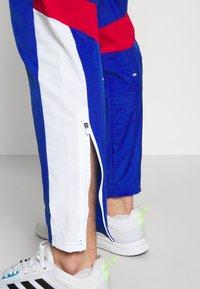 adidas Performance - TRACK - Träningsbyxor - team royal blue/white/scarlet - 3