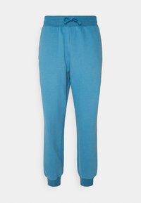 LONG PANTS - Tracksuit bottoms - light blue