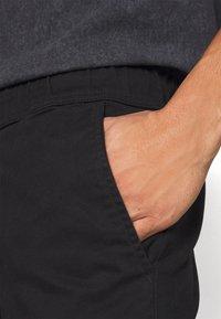 Night Addict - NAASTRID - Cargo trousers - black - 7