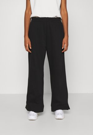 ROXA - Tracksuit bottoms - black