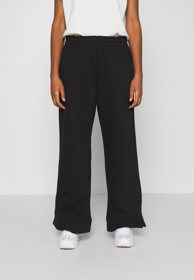 ROXA - Pantaloni sportivi - black