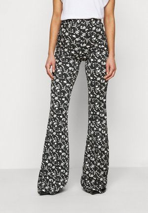 FLORAL FLARE - Trousers - black
