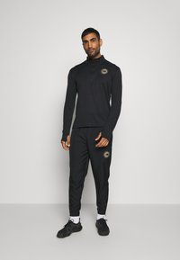 Nike Performance - ESSENTIAL PANT - Tracksuit bottoms - black/particle grey - 1