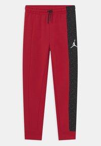 Jordan - AIR SPECKLE PANTS - Tracksuit bottoms - gym red - 0