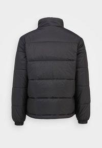 adidas Originals - PADDED STAND PUFF ORIGINALS WINTER JACKET FILLED THIN - Winter jacket - black - 1