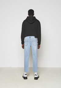 Versace Jeans Couture - SIOUX  - Jeans Tapered Fit - light blue denim - 2