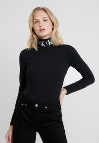 Calvin Klein Jeans - MONOGRAM TAPE ROLL NECK - Top s dlouhým rukávem - black - 0