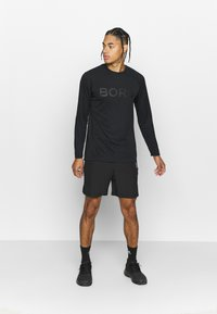 Björn Borg - ADILS SHORTS - Sports shorts - black beauty