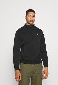Calvin Klein Jeans - HARRINGTON PADDED JACKET - Light jacket - black - 0