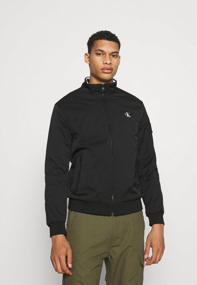 Calvin Klein Jeans - HARRINGTON PADDED JACKET - Light jacket - black