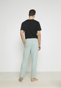 Hollister Co. - LOUNGE BOTTOM JOGGERS - Pyjama bottoms - blue wash - 2