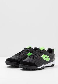 Lotto - STADIO 300 II TF - Voetbalschoenen voor kunstgras - all black/spring green - 2