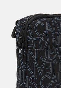 Calvin Klein Jeans - LOGO FLAT CROSS BODY BAG - Across body bag - black - 3
