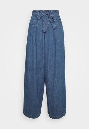 Široké džíny - blue medium wash