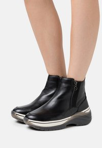 Tamaris Pure Relax - Ankle boots - black - 0