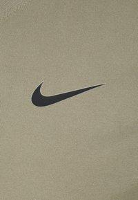 Nike Performance - TEE CREW SOLID - Basic T-shirt - light army/black - 6
