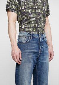 Nudie Jeans - STEADY EDDIE II - Straight leg jeans - indigo shades - 4