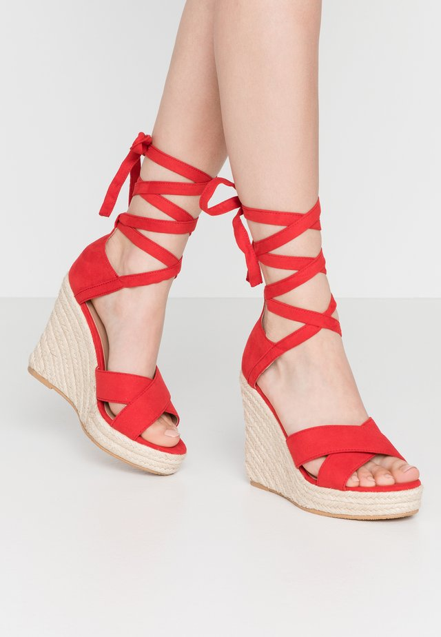 High heeled sandals - red