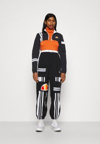Ellesse - LAUDE CROP TRACK  - Summer jacket - black - 1