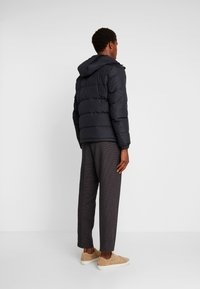 Tommy Hilfiger - HOODED REDOWN BOMBER - Down jacket - black - 2
