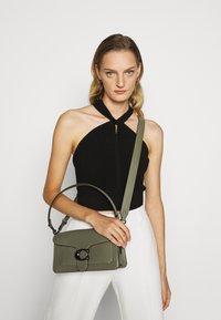 Coach - TABBY POLISHED SMALL FLAP BAG HANDBAG - Handbag - light fern - 0