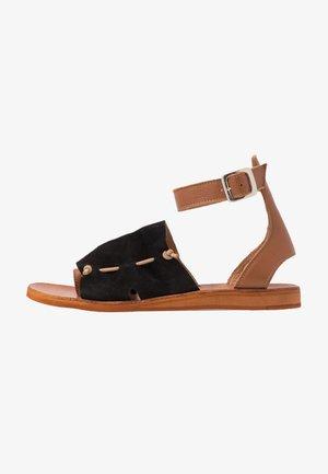 CAROLINA  - T-bar sandals - black